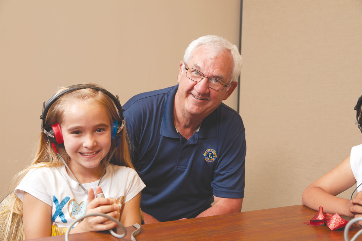 Steve Bennett with school child during hearing test
