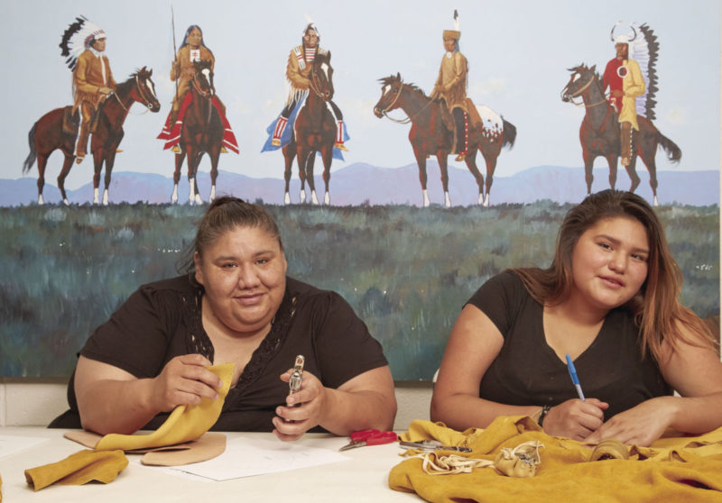 Karlyn Walker and her daughter making native crafts
