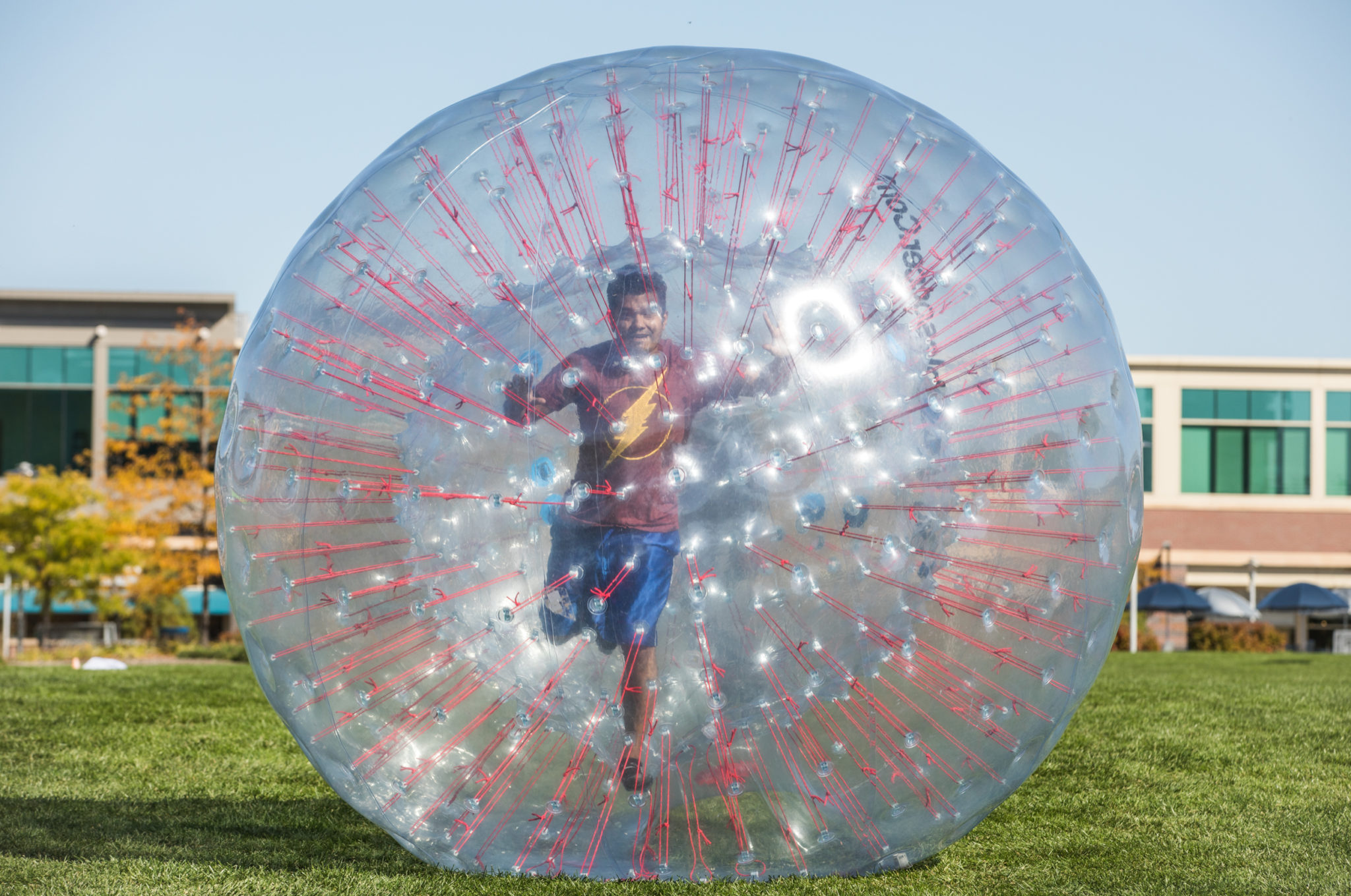 man running in giant bubble