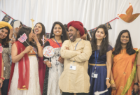 Group of Indian women and men celebrating Diwali