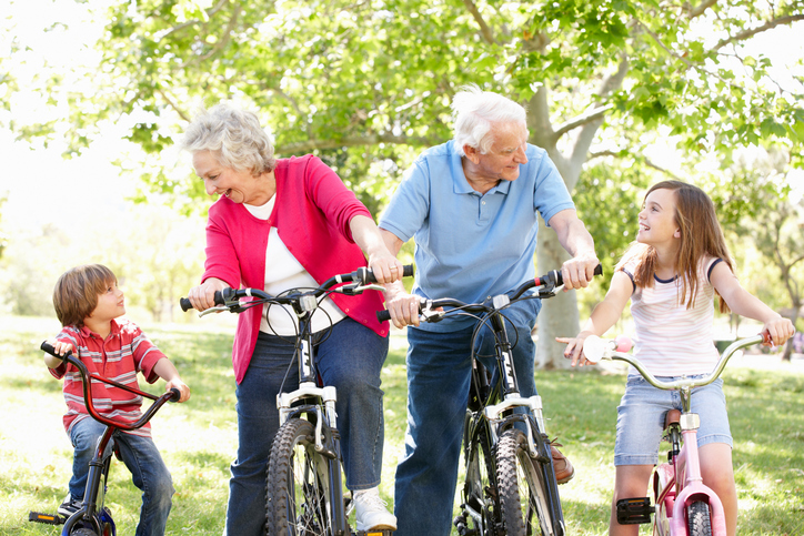 Grandparents riding bike with their grandchildren