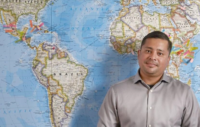 Teacher in front of map