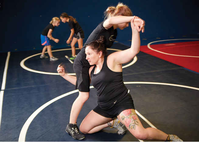 Female wrestling with child