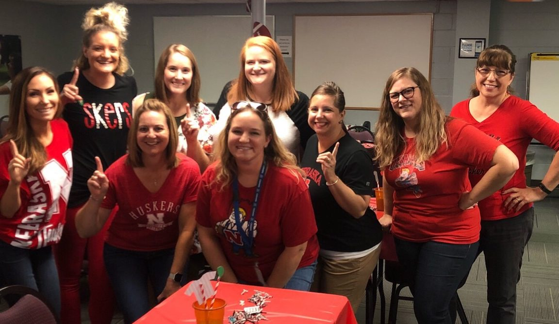 CEDARS wellness committee at a 2018 tailgate party, one of their wellness program events.