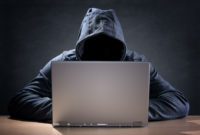 Hacker on laptop