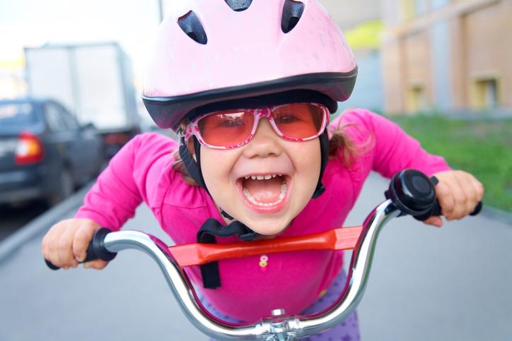 Girl in pink bike helmet