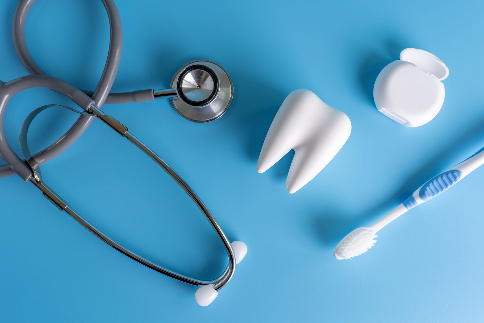 Close-Up Of Dental Equipment Over Blue Background